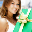 Portrait of young excited pretty woman standing inside shopping — Stock Photo #6859118