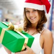 Portrait of young excited pretty woman standing inside shopping — Stock Photo #6859132