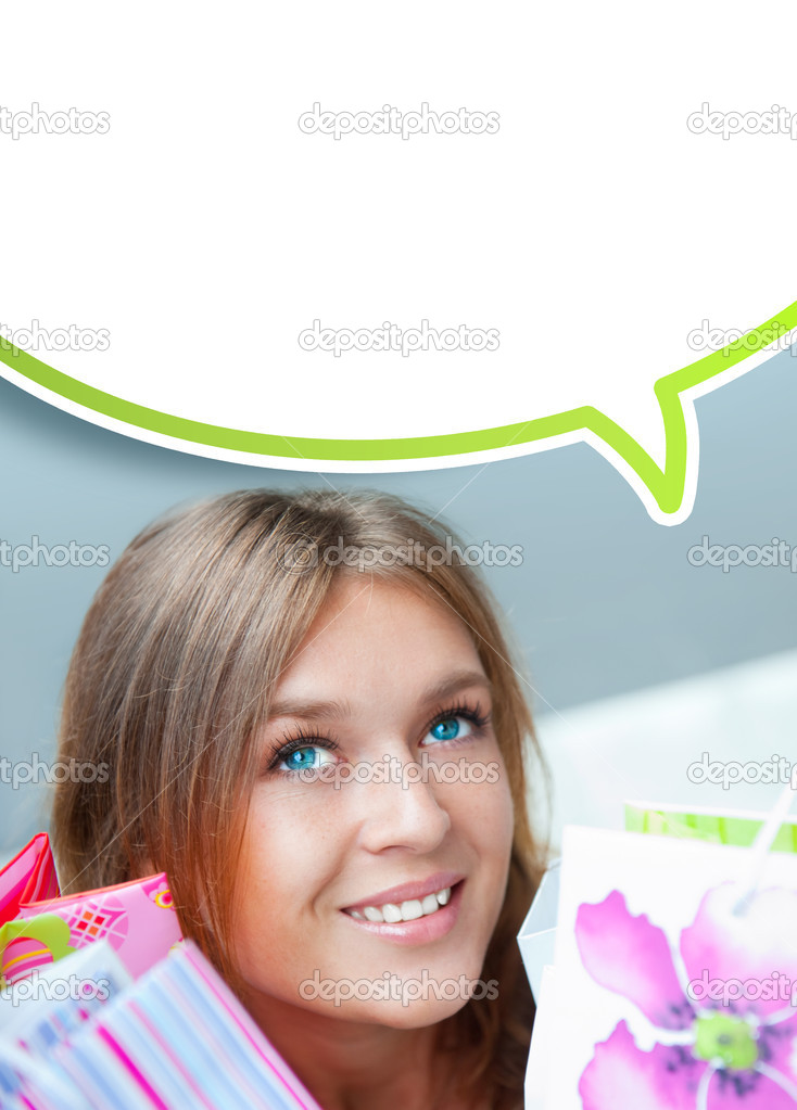 Shopping woman with lots of bags smiles inside mall. She is happy about huge christmas preseason discounts. Blank balloon with lots of copyspace for your text a — Stock Photo #6859041