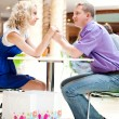 Royalty-Free Stock Photo: Closeup portrait of young cute couple at mall cafe.
