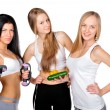 Stock Photo: Three beautiful young women wearing sportswear isolated against