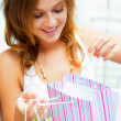 Closeup portrait of young happy woman with shopping bags at mall — Stock fotografie