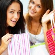 Two happy women at a shopping center with bags. Seasonal prepart — Stock Photo #6872338