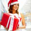 Closeup portrait of young cheerful brunette woman wearing Santa — Stock Photo #6872572