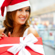 Closeup portrait of young cheerful brunette woman wearing Santa — Stock Photo #6872584