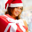 Closeup portrait of young cheerful brunette woman wearing Santa — Stock Photo #6872587