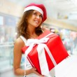 Closeup portrait of young cheerful brunette woman wearing Santa — Stock Photo #6872593