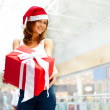 Closeup portrait of young cheerful brunette woman wearing Santa — Stock Photo #6872603