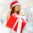 Closeup portrait of young cheerful brunette woman wearing Santa — Stock Photo #6872671