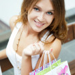 Photo of young joyful woman with shopping bags on the background — Stock Photo #6872693
