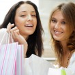 Two excited shopping woman together inside shopping mall. Horizo — Stock Photo #6872773