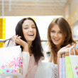 Two excited shopping woman together inside shopping mall. Horizo — Stock Photo #6872805