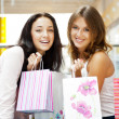 Two excited shopping woman together inside shopping mall. Horizo — Stock Photo #6872821