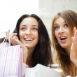 Two excited shopping woman together inside shopping mall. Horizo — Stock Photo