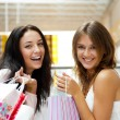 Two excited shopping woman together inside shopping mall. Horizo — Foto Stock