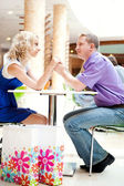 Closeup portrait of young cute couple at mall cafe. — 图库照片