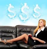 Portrait of a happy young woman sitting on sofa using diary — Stock Photo