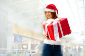 Portrait of an excited attractive woman with red box and white r — Stock Photo