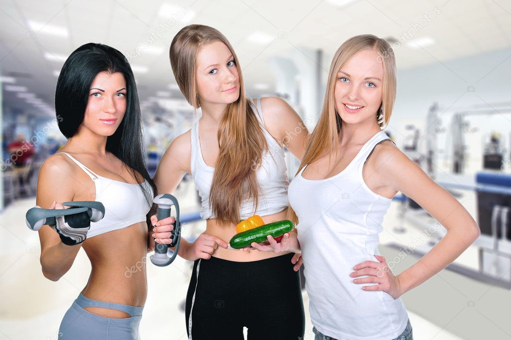Three beautiful young women wearing sportswear inside gym for Gimnasio yong
