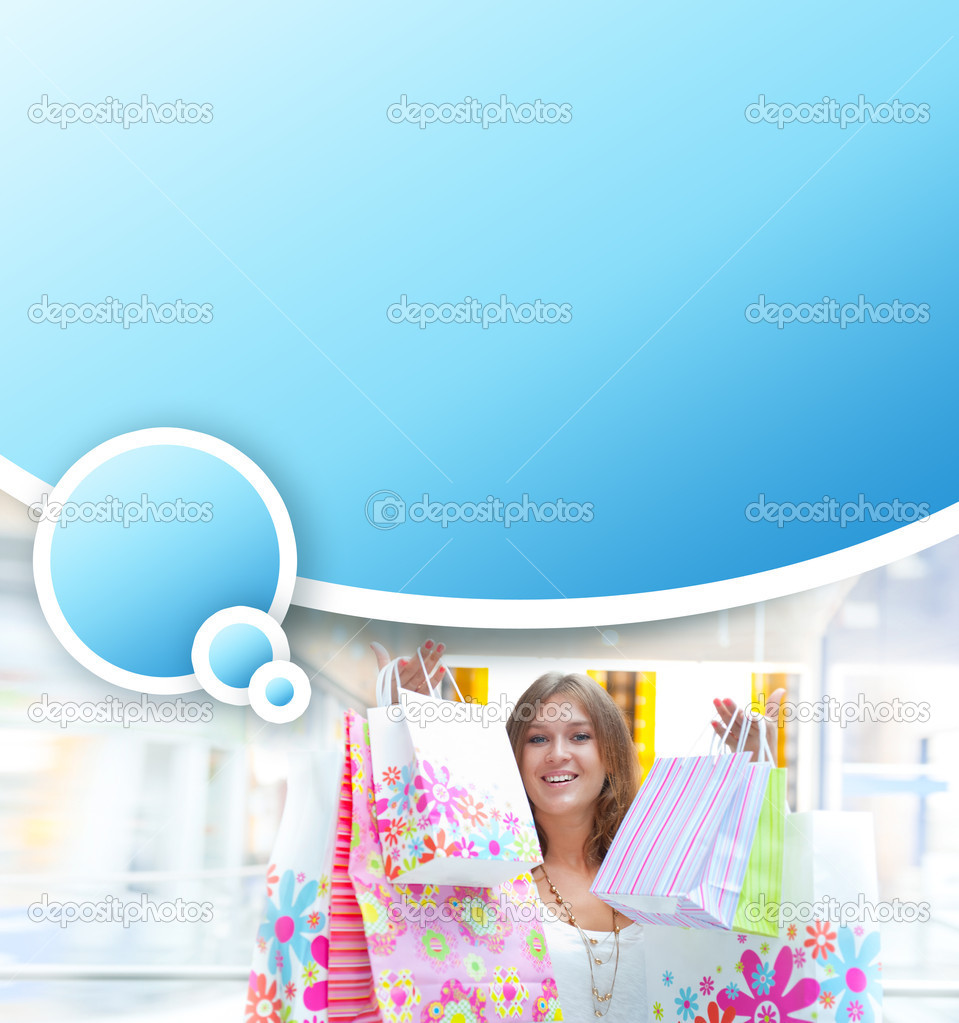 Shopping woman with lots of bags smiles inside mall. She is happy about huge christmas preseason discounts. Blank balloon with lots of copyspace for your text a — Stock Photo #6872282