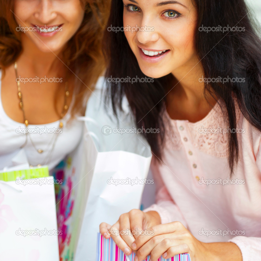 Two happy women at a shopping center with bags. Seasonal preparty shopping boom. — Stock Photo #6872649
