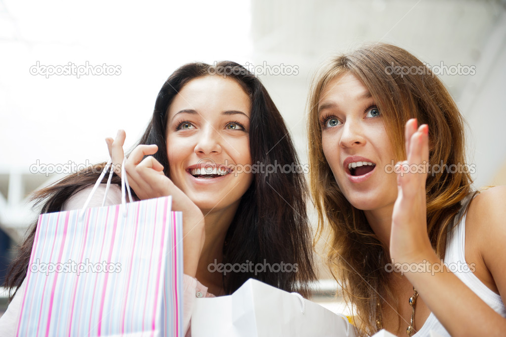 Two excited shopping woman together inside shopping mall, surprised about low prices and sales before christmas and boxing day. Horizontal Shot  Stock Photo #6872833
