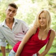 Stock Photo: Portrait of young pretty woman and her male gay friend playing t