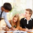 Teacher helping students in school classroom. Horizontally frame — Stock Photo