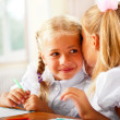 Two little girls gossip in classroom — Stock Photo #6939443