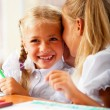 Two little girls gossip in classroom — Stock Photo #6939449
