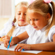 Little girls drawing pictures and writing letters to Santa Claus — Stock Photo