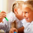 Two little girls gossip in classroom — Stock Photo #6939461