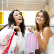 Two excited shopping woman together inside shopping mall. Horizo — Foto de Stock