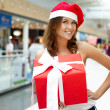Portrait of young excited pretty woman standing inside shopping — Stok fotoğraf