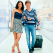 Stock Photo: Young tourists . At modern international airport
