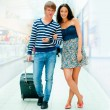 Young tourists . At modern international airport - Stock Photo