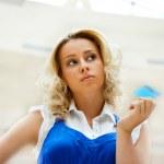Beautiful shopping woman holding a credit card — Stock Photo