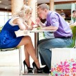 Closeup portrait of young cute couple at mall cafe. - Foto Stock