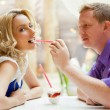 Closeup portrait of young cute couple at mall cafe. Man proposin — Stock Photo #6939585