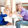 Closeup portrait of young cute couple at mall cafe. - Stock Photo