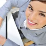 Beautiful business woman thinking about somethinking while worki — Stock Photo