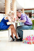 Closeup portrait of young cute couple at mall cafe. — Stock Photo