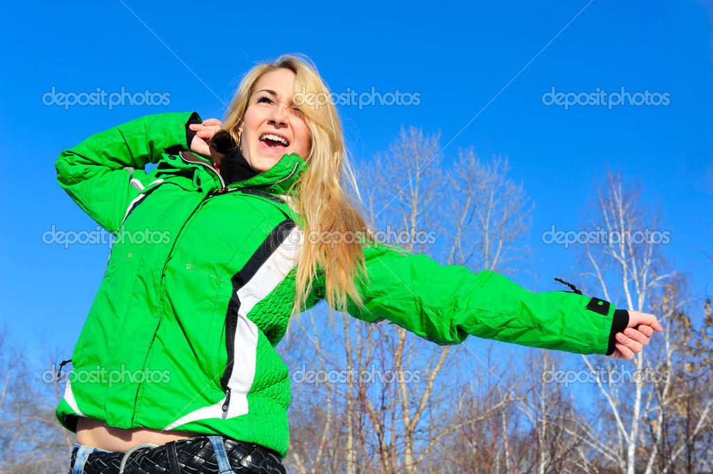 Closeup portrait of young pretty woman outdoor in winter park in action  Stock Photo #6939575