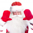 Christmas theme: Santa Claus bowing something from his arms — Stock Photo