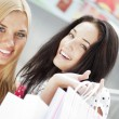 Group of beautiful shopping women with bags and smiling — Stock Photo #7070741