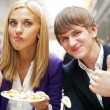 Closeup portrait of an attractive young couple eating fruit sala — Stock Photo #7070779