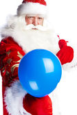 Traditional Santa Claus holding balloons for children. Isolated — Stock Photo