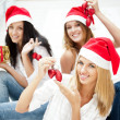 Group of three beautiful girls sitting on stairs at shopping mal — Stock Photo #7092523