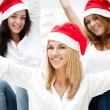 Group of three happy pretty girls are celebrating christmas and — Stok fotoğraf #7092529