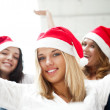 Group of three happy pretty girls are celebrating christmas and — Stock Photo #7092537